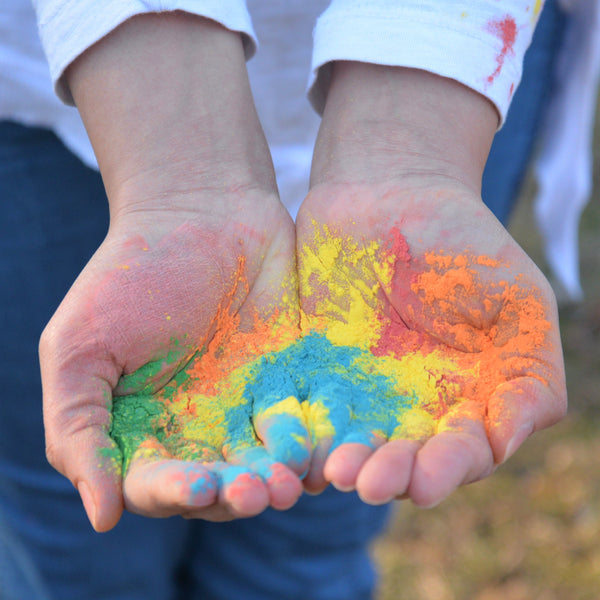 Holi colored powder in hands