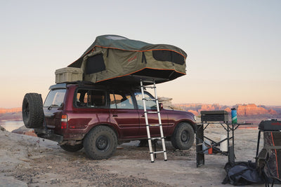 Vagabond Rooftop Tent in Forest Green Hyper Orange shown on Toyota Land Cruiser