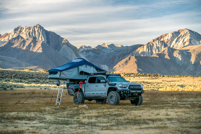 Vagabond Rooftop Tent in Slate Grey Navy Blue with ladder on a Toyota Tacoma