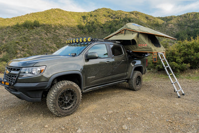 Vagabond Lite Rooftop Tent in Forest Green Hyper Orange on a Chevy Colorado Truck