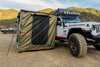 ROAM Adventure Co. Rooftop Awning Room in Forest Green shown on a Jeep Rubicon