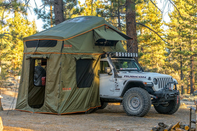 Vagabond XL Rooftop Tent in Forest Green with Annex Room shown on a Jeep Rubicon