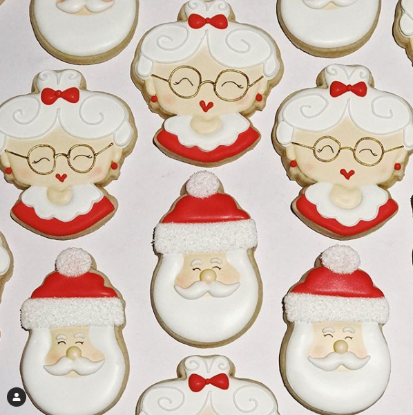 Santa Claus and Mrs. Santa Claus's head decorated cookies.