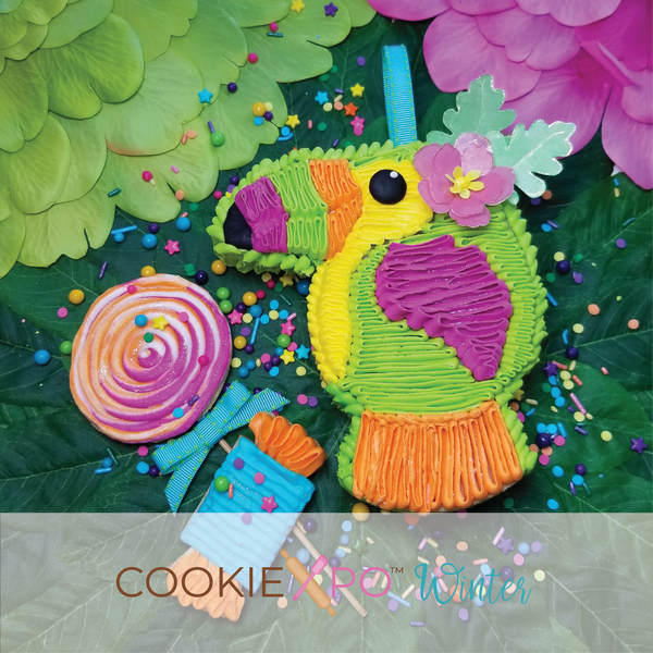 Sugartess fiesta cookie cutter in shape of a girl toucan bird piñata with a flower on head.