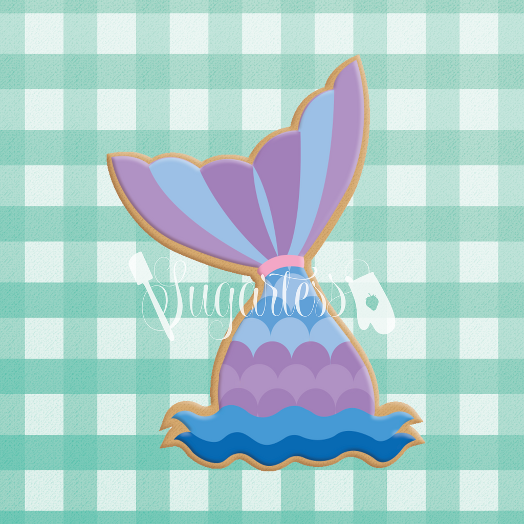 Sugartess custom cookie cutter in shape of mermaid tail.