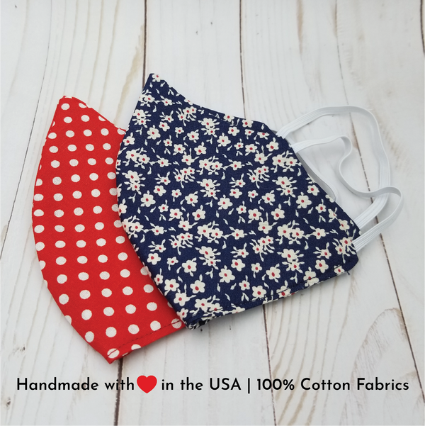 Handmade reusable and washable 100% cotton fabric face masks mouth covers. 2 prints available: red and white polka dots and navy blue and small white flowers with tiny red center.