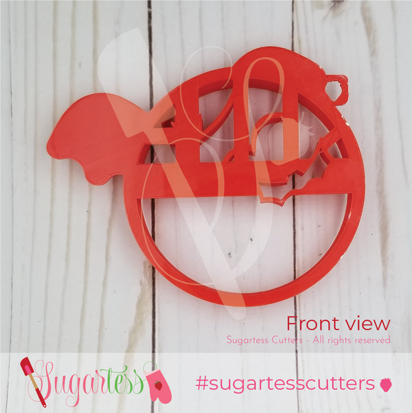 Sugartess custom stamp cookie cutter in shape of bats flying past the full moon.