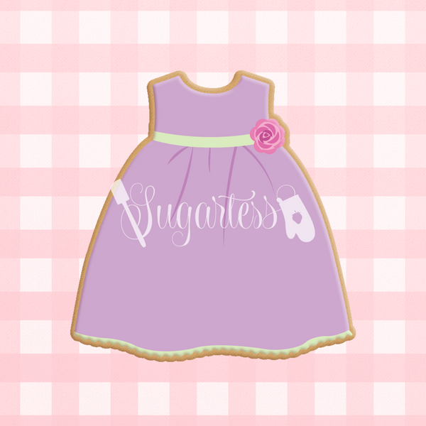 Sugartess custom cookie cutter in shape of baby girl dress.