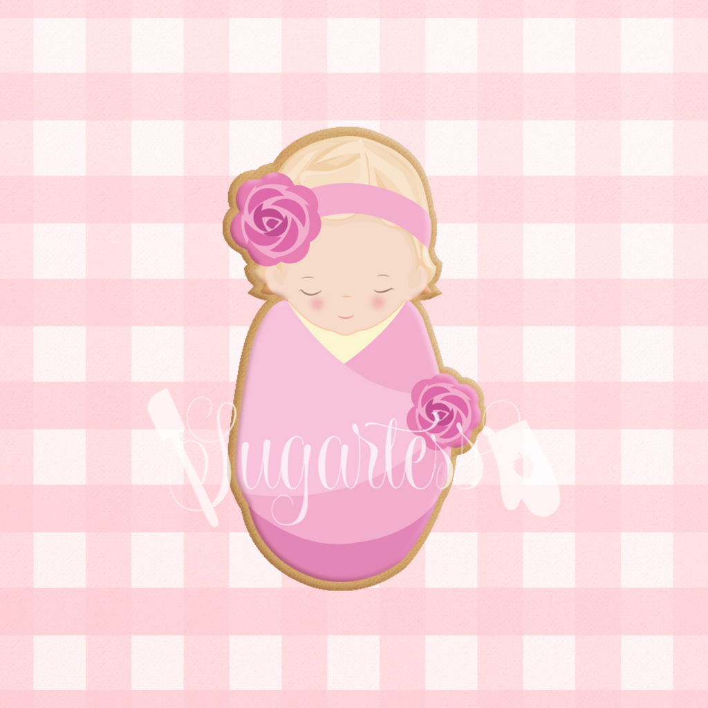 Sugartess custom cookie cutter in shape of sleeping baby girl wrapped in swaddle blanket.