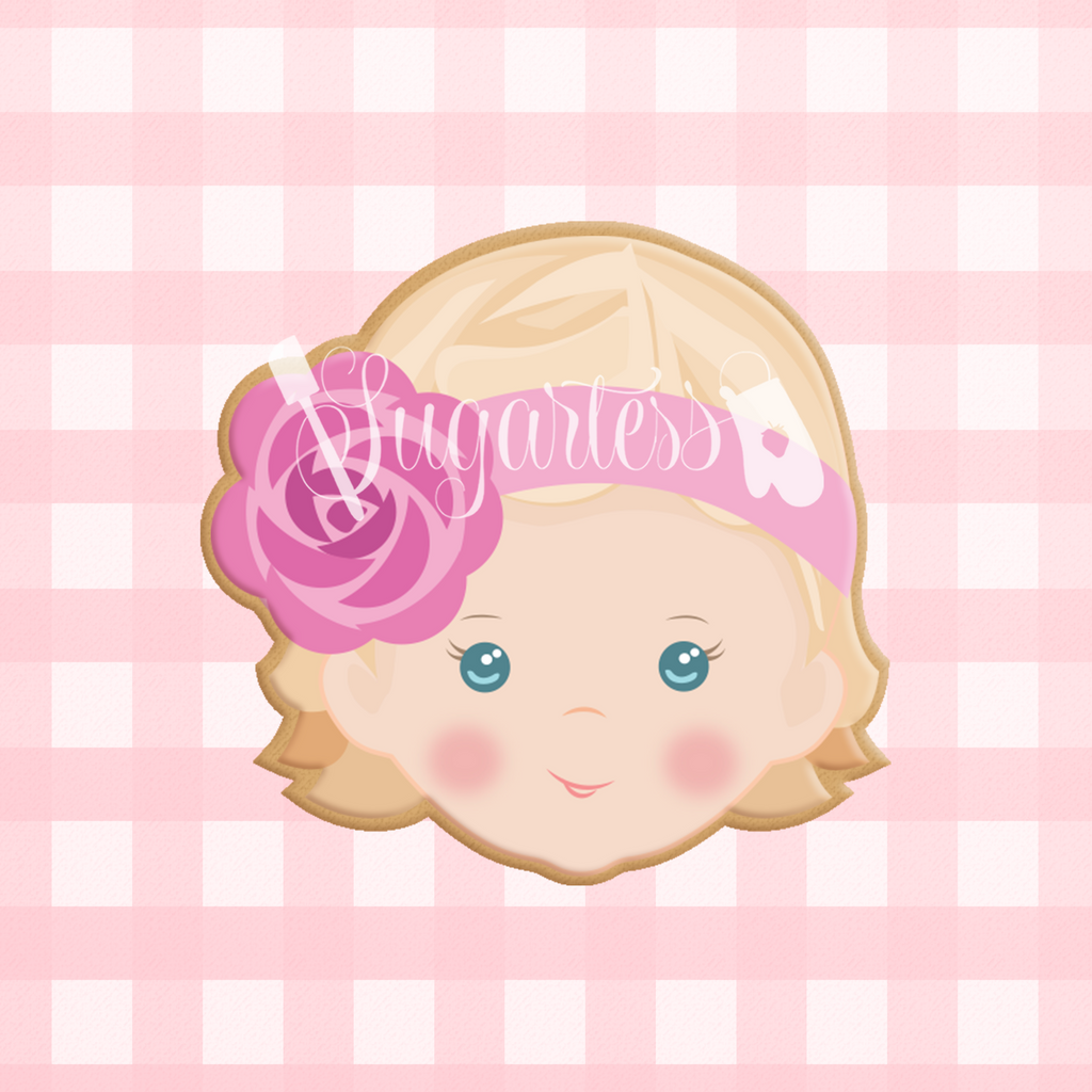 Sugartess custom cookie cutter in shape of a baby girl head with floral headband.