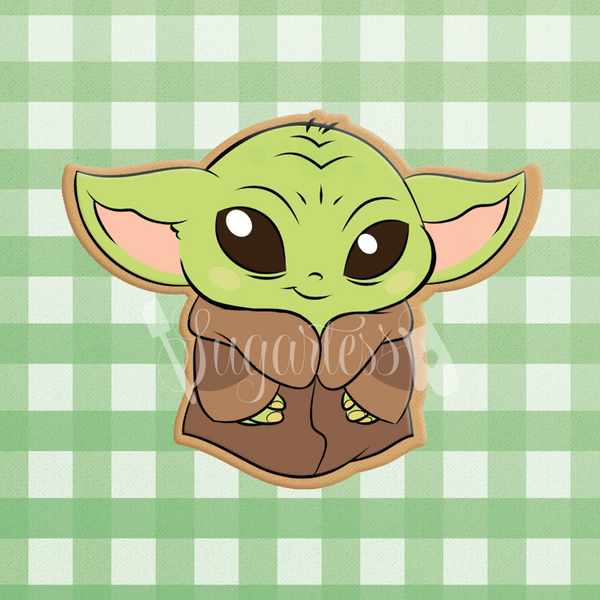 Sugartess custom cookie cutter in shape of standing Baby Yoda.