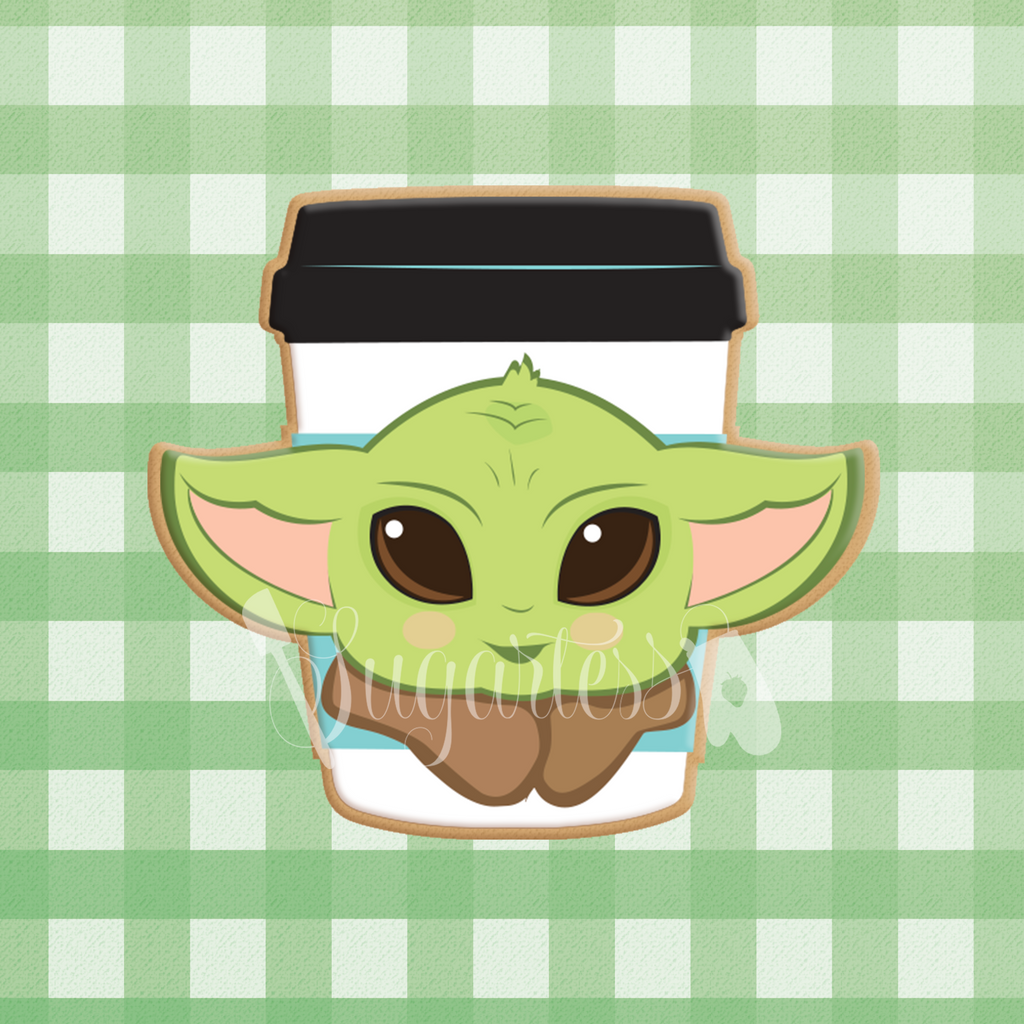 Sugartess custom cookie cutter in shape of coffee cup decorated with Baby Yoda head.