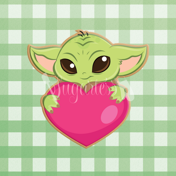 Sugartess custom cookie cutter in shape of Baby Yoda holding heart.