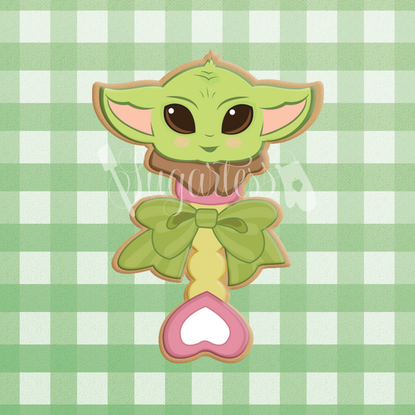 Sugartess custom cookie cutter in shape of Baby Yoda toy rattle.
