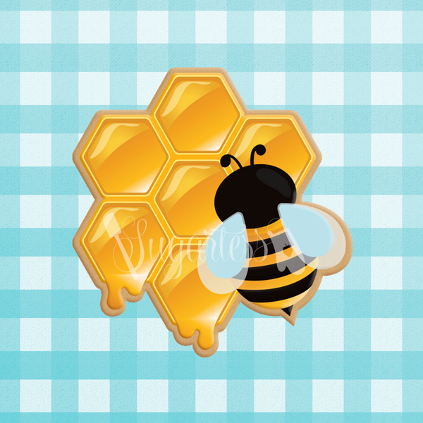 Sugartess custom cookie cutter in shape of dripping honeycomb with bumblebee on top.