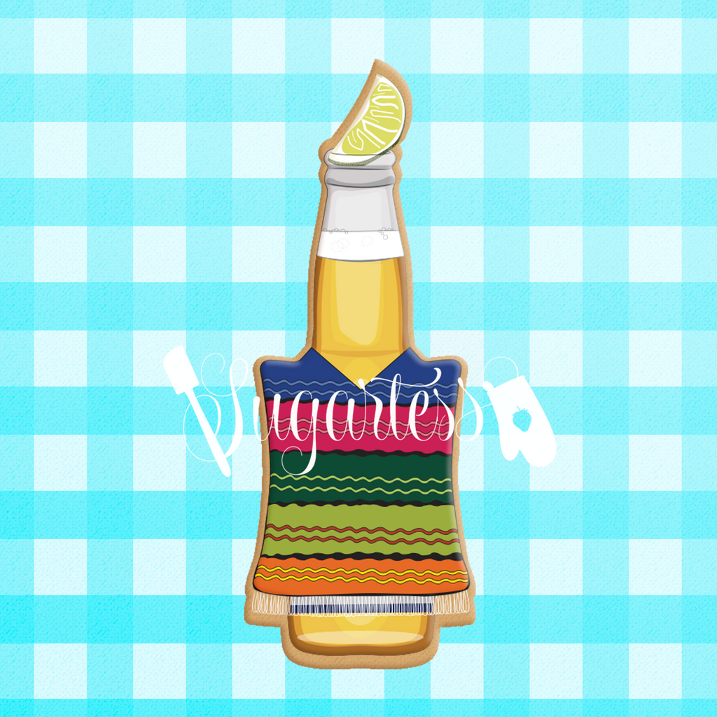 Sugartess custom cookie cutter in shape of beer bottle with lemon wedge and Mexican poncho.