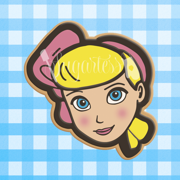 Sugartess custom cookie cutter in shape of head of Toy Story Bo Peep character.