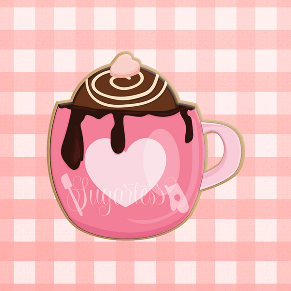 Sugartess custom cookie cutter in shape of a hot chocolate bomb in a pink cup.