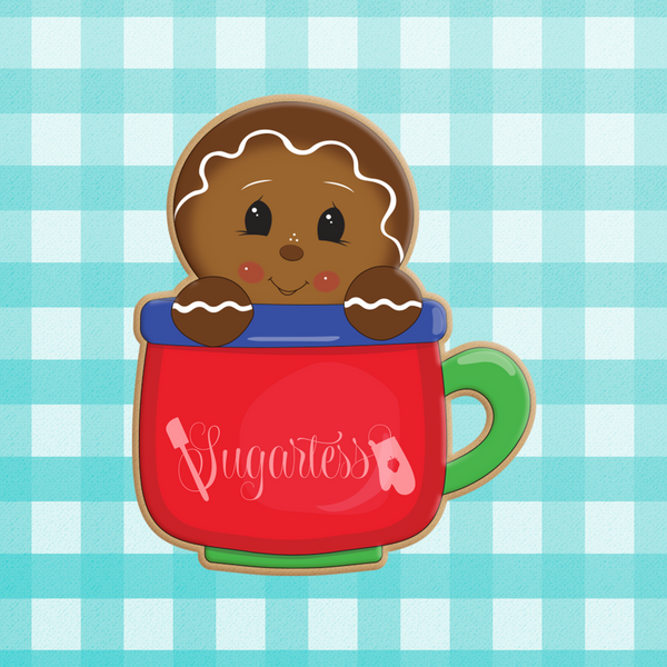 Sugartess custom holiday cookie cutter in shape of a gingerbread man peeking out of a mug.