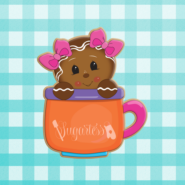 Sugartess custom holiday cookie cutter in shape of a gingerbread girl with 2 head bows peeking out of a mug.