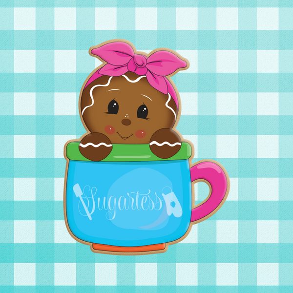Sugartess custom holiday cookie cutter in shape of a gingerbread girl with headband peeking out of a mug.