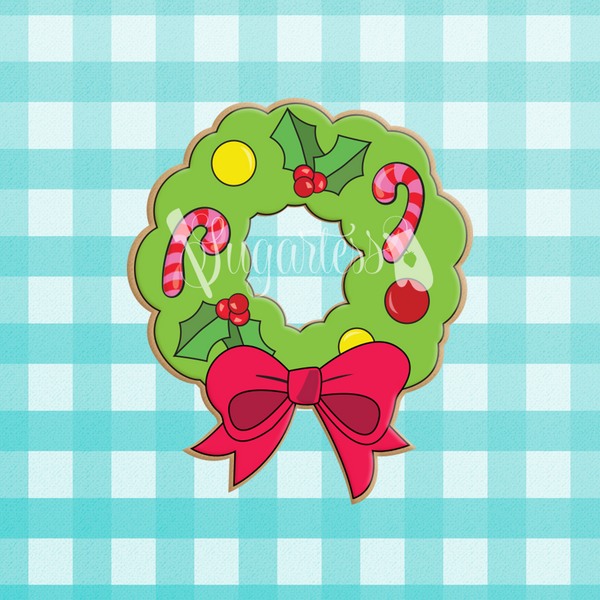 Sugartess custom holiday cookie cutter in shape of a wreath with bow and cutout center.