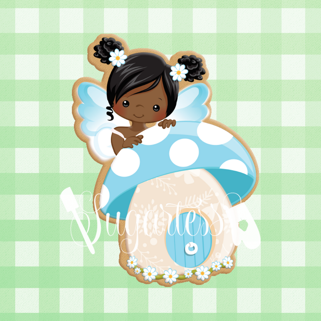 Sugartess custom cookie cutter in shape of blue fairy with mushroom house.