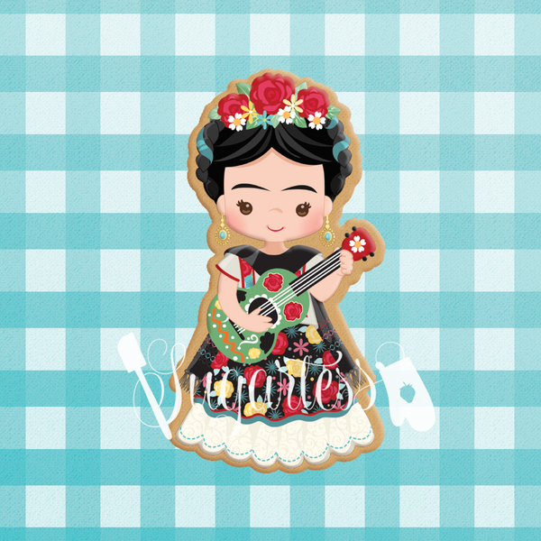 Sugartess custom cookie cutter in shape of Frida Khalo playing guitar.
