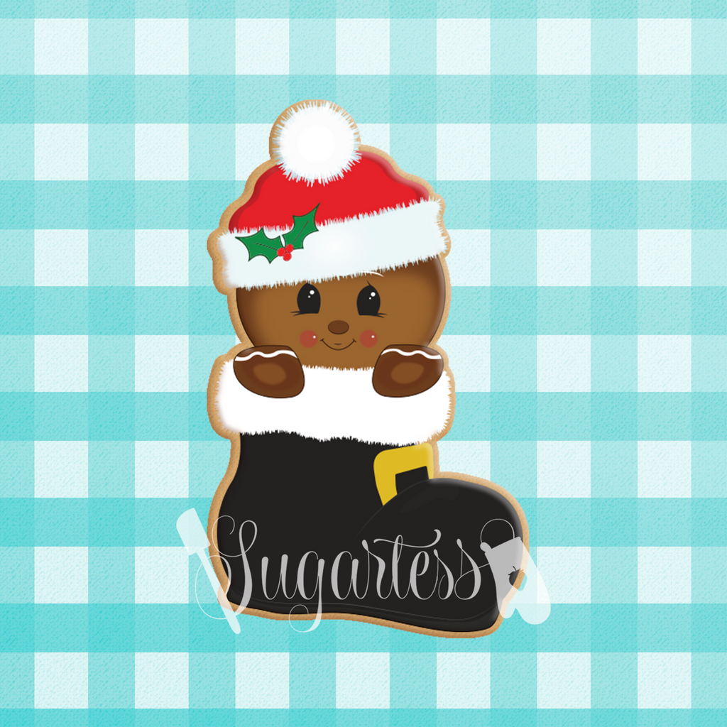Sugartess cookie cutter in shape of gingerbread man inside Santa's Boot