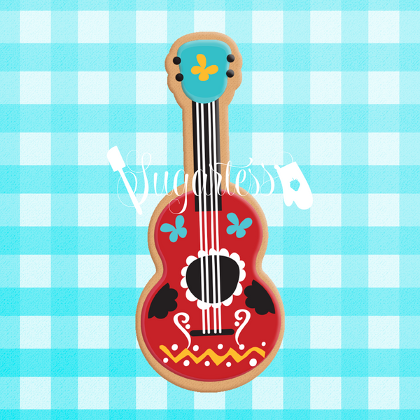 Sugartess custom cookie cutter in shape of guitar.