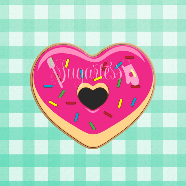 Sugartess custom cookie cutter in shape of heart-shaped donut with cut-out center.