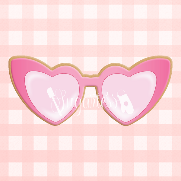 Sugartess custom cookie cutter in shape of heart-shaped glasses.
