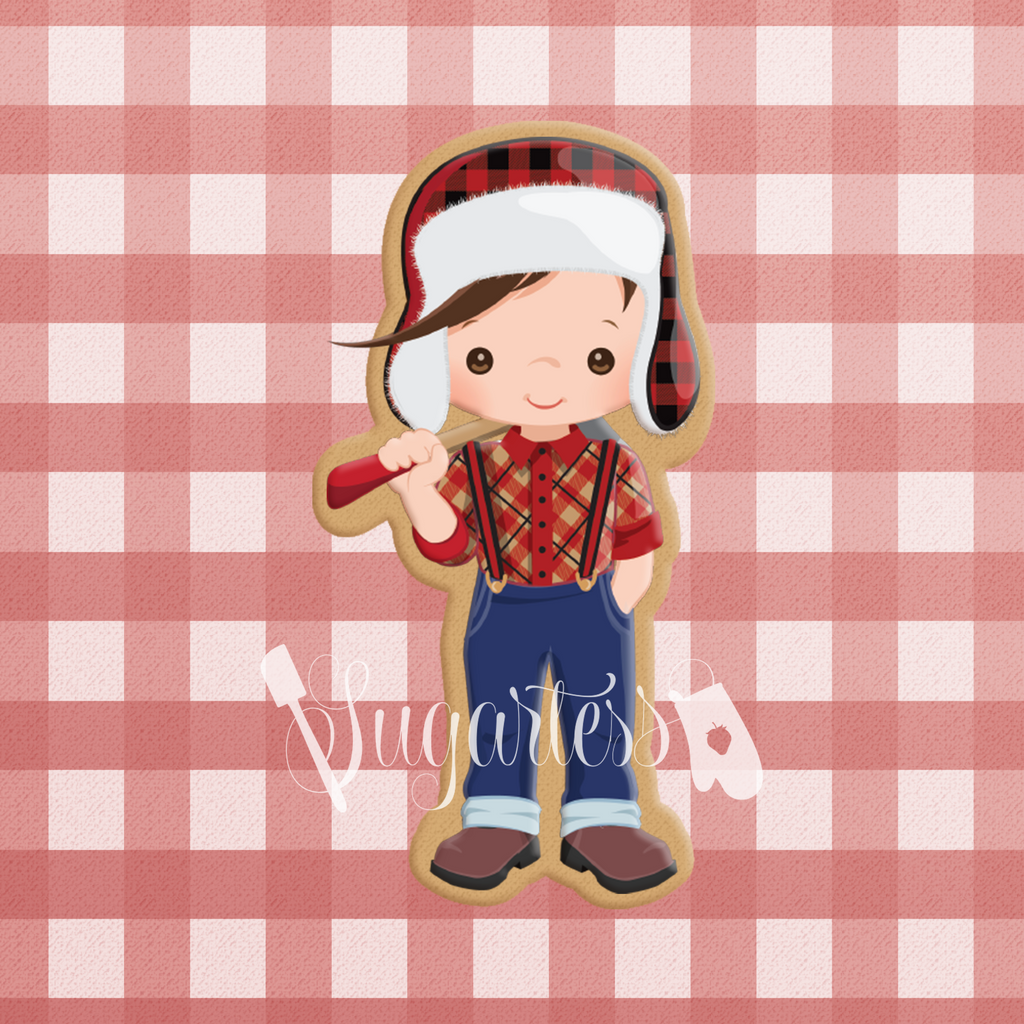 Sugartess custom cookie cutter in shape of a lumberjack kid wearing a trapper hat and carrying an ax.
