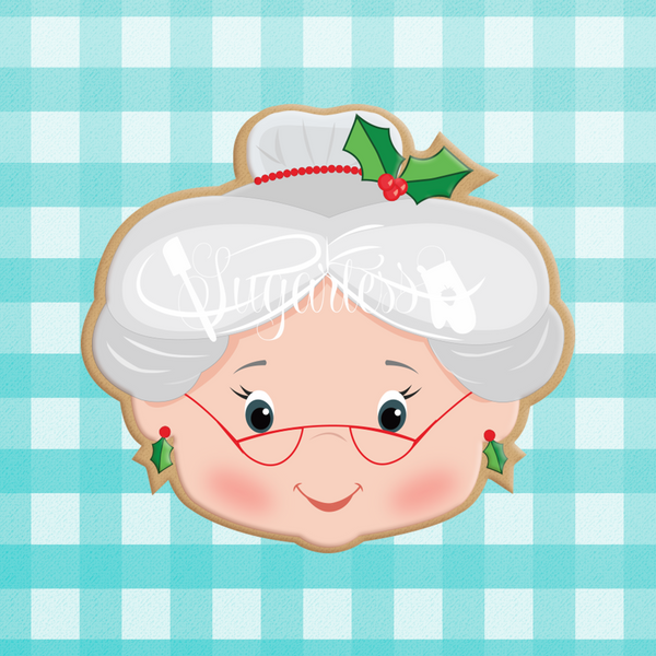 Sugartess custom holiday cookie cutter in shape of Mrs. Santa Claus Head with Holly Leaf Headpiece and Earrings.
