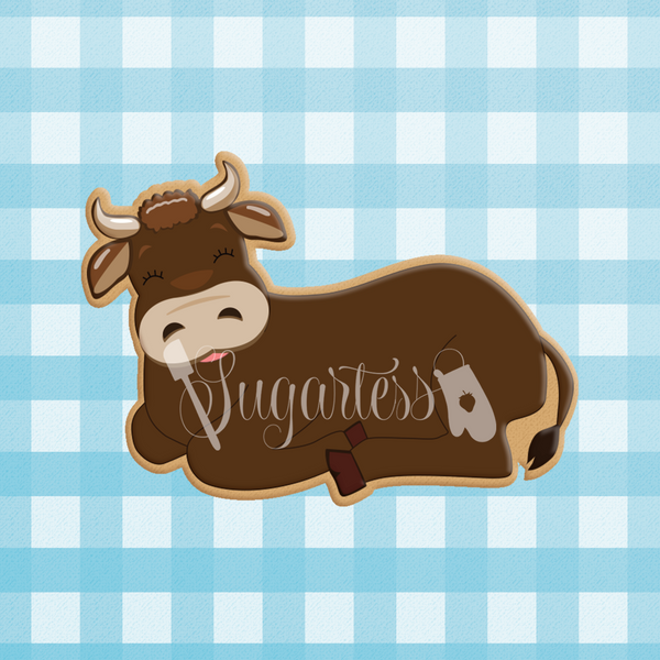 Sugartess custom cookie cutter in shape of an ox, bull or cow lying down.