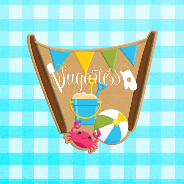 Sugartess custom cookie cutter in shape of beach scenery of flag poles, sand bucket, crab and beach ball.