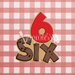 Sugartess custom cookie cutter in shape of number 6 with wood plank letter number six.