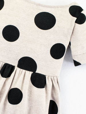 black polka dots on a tan dress for little girls