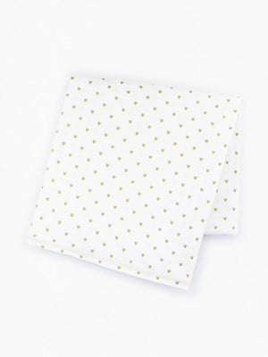 white organic cotton baby blanket with tiny printed gold crowns folded