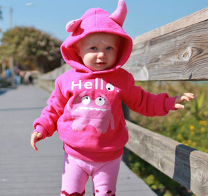 pink monster hoodie with horns saying hello
