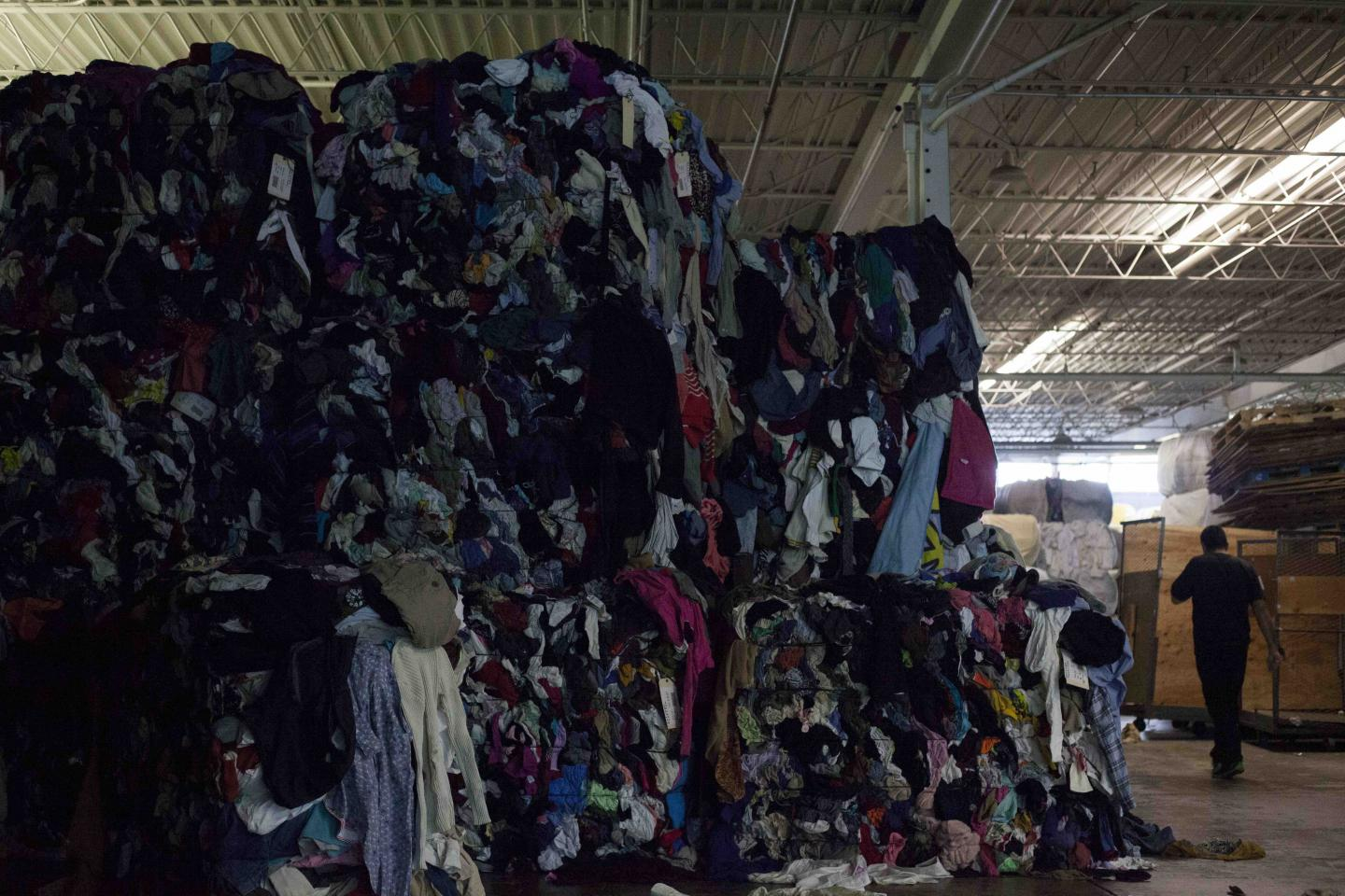 newsweek's picture of floor to ceiling pile of discarded clothes