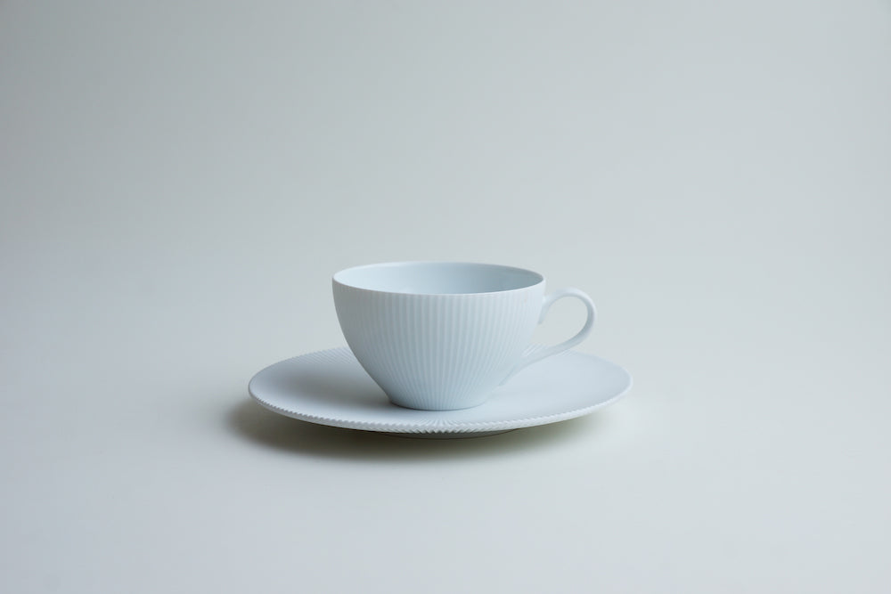 White blast tea cup and saucer