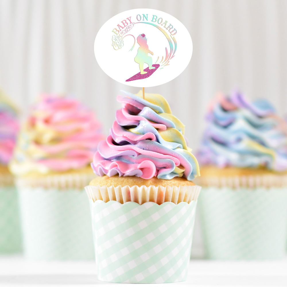 Load image into Gallery viewer, pastel swirl cupcakes with a cake topper printed with Baby On Board - Surfing Girl svg in holographic and glitter
