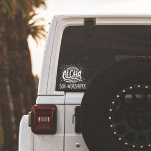 aloha son worshiper svg decal on a whte Jeep in the tropics