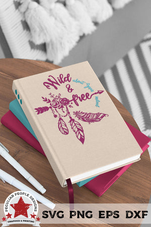 wild and free svg shown printed as a decal on a journal in a bohemian style room