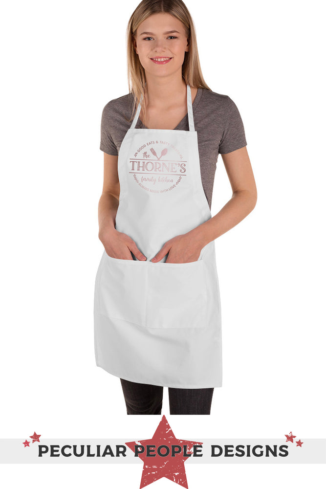 a young woman wearing a personalized family kitchen apron in white