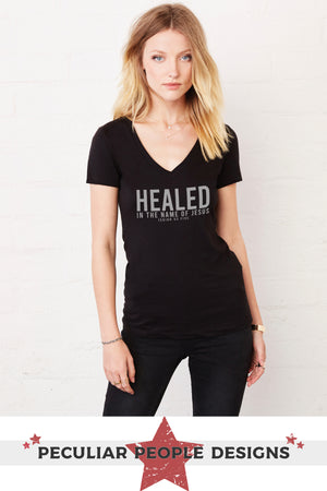 a beautiful woman wearing the healed, isaiah 53 v neck shiet