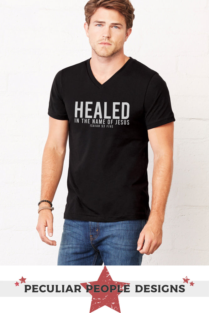 a handsome young man wearing the healed, Isaiah 53 v neck shirt