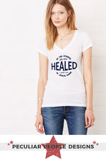 a pretty young woman wearing bluejeans and a healed shirt