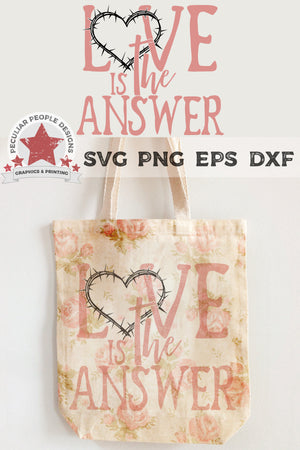 Load image into Gallery viewer, love is the answer svg printed on a tote bag with a vintage floral pattern